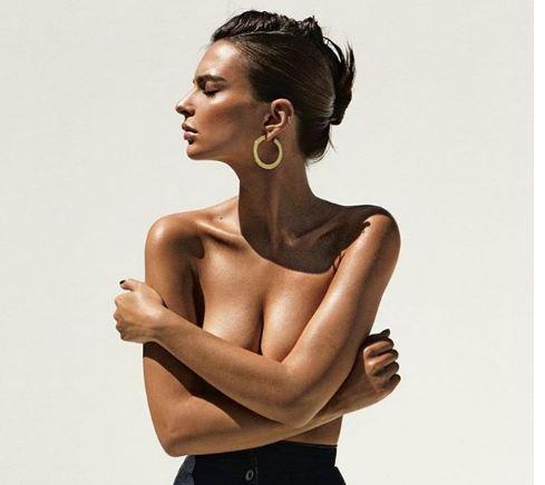 Emily Ratajkoski poses in swimwear
