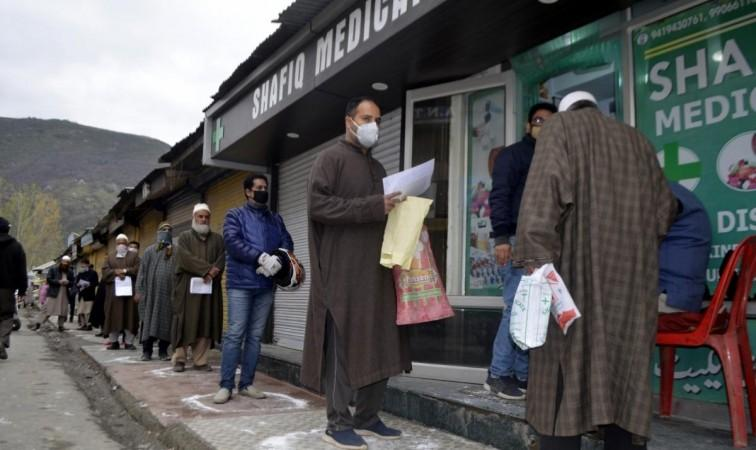 Baramulla: People strictly practising social distancing while they queue up to buy medicines outside a medical store during 21-day long nationwide lockdown imposed as a precautionary measure to contain the spread of COVID-19, in Jammu and Kashmir's Baramu