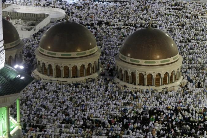 Muslim pilgrims pray around the holy Kaaba at the Grand Mosque in Mecca during Hajj pilgrimage