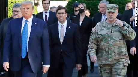 """Gen. Mark Milley, chairman of the Joint Chiefs of Staff, right, has since called his presence at Trump's St. John's Church walk """"a mistake""""."""