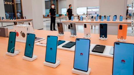 Smartphones are displayed at a Huawei store ahead of its opening in Shanghai this month.