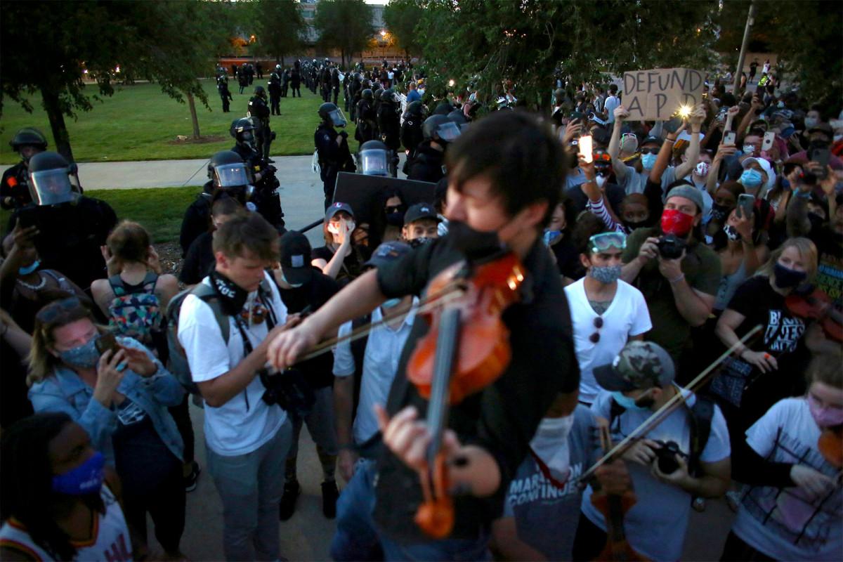 Cops probed for reenacting Elijah McClain chokehold near memorial