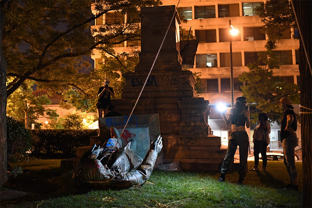 DC protesters topple, torch confederate statue on Juneteenth