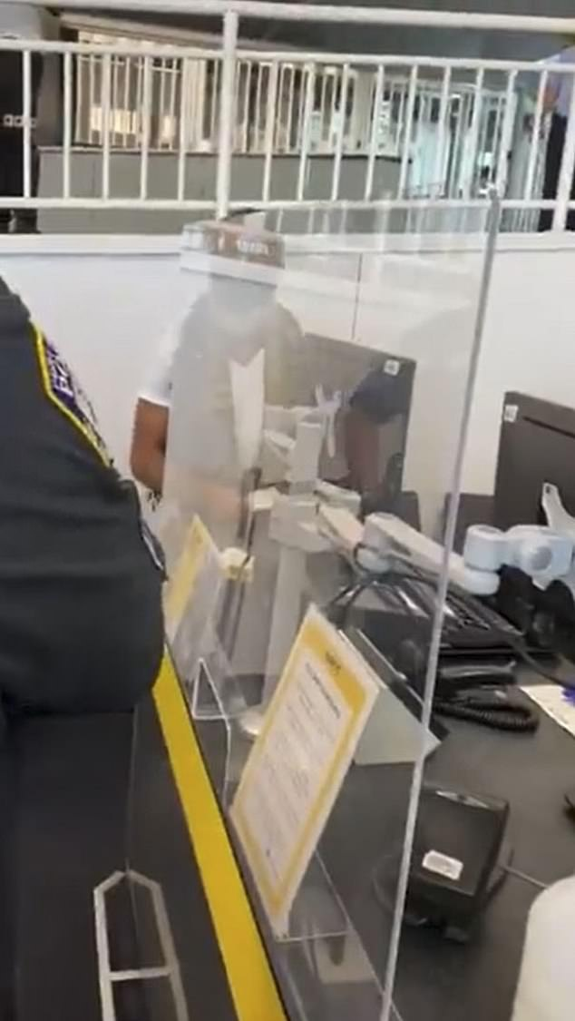 Cell phone footage appeared to show the man (center) being arrested by Port Authority officers after being removed from the flight