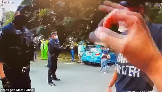 They said the officer flashed the hand sign to make sure the counter-protester was okay after the fall