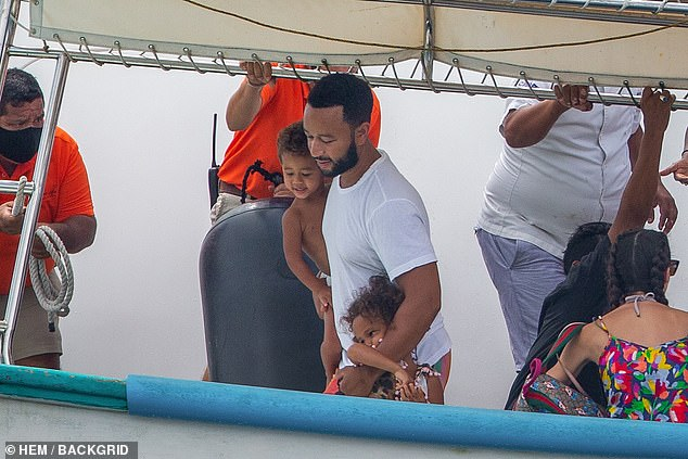 Good daddy: Legend had his arms around both his son Miles and daughter Luna