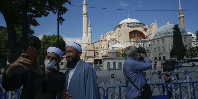 Turkey's President Recep Tayyip Erdogan formally reconverted Hagia Sophia into a mosque and declared it open for Muslim worship, hours after a high court annulled a 1934 decision that had made the religious landmark a museum. (AP Photo/Emrah Gurel)