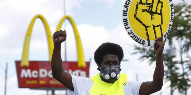 Jerry Johnson takes part in a protest rally outside a McDonald's in Detroit on July 20. (AP Photo/Paul Sancya)