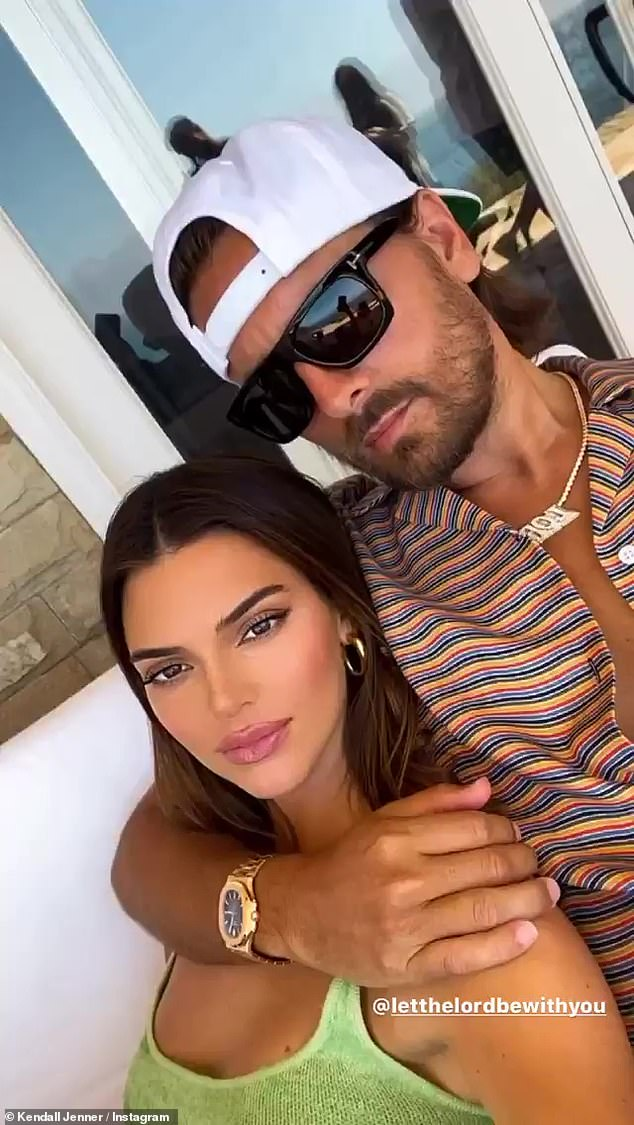 Family first: When she is not hanging out with her pals, Kendall has been getting in plenty of family time with sister Kourtney Kardashian, Kourtney's ex Scott Disick, and their three children; Kendall pictured with Scott Disick on Instagram on Sunday