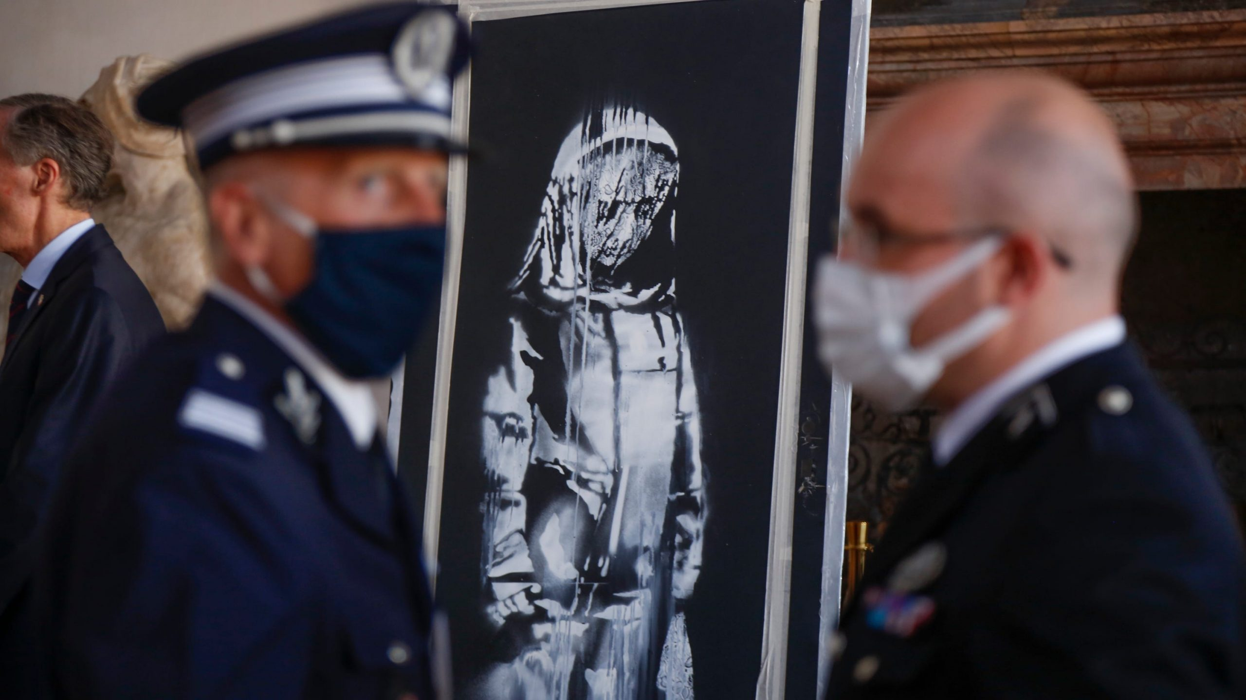 Banksy tags experience mask avenue artwork as Italy returns stolen get the job done to France