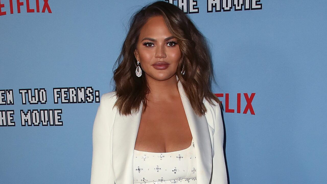Chrissy Teigen posts online video of breast implant elimination scars simply because 'nobody believes' she experienced medical procedures