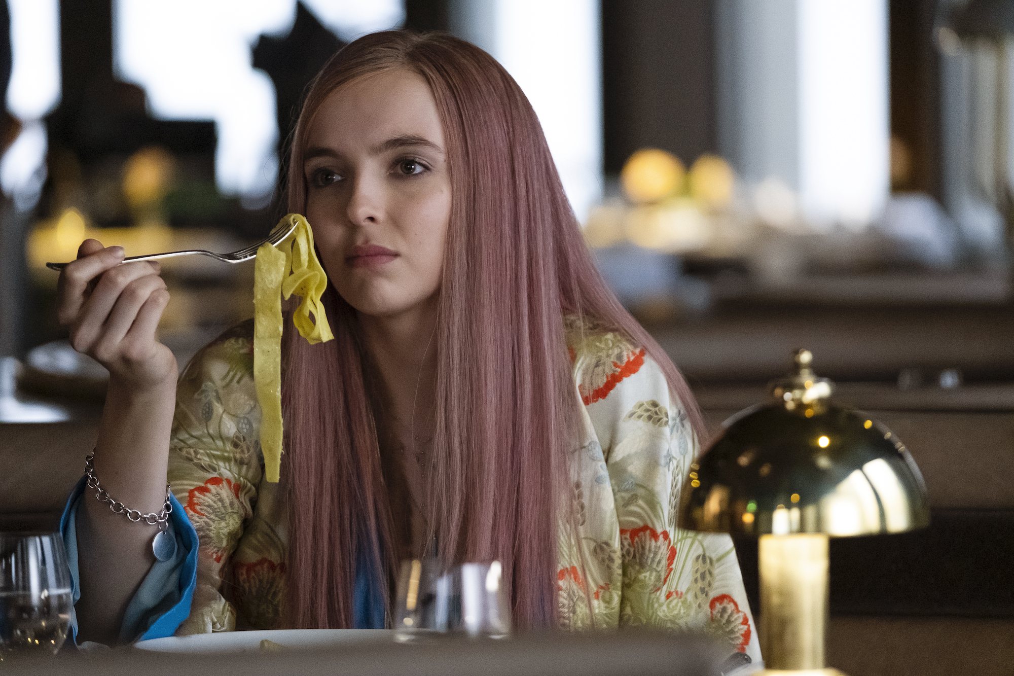 Jodie Comer as Villanelle in Season 2, eating pasta.