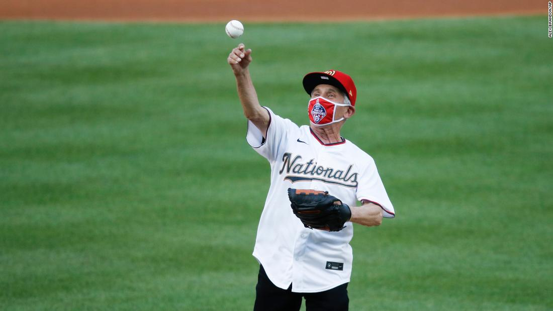 Dr. Fauci takes a break from battling the pandemic to throw the very first pitch of the MLB year