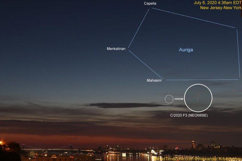 A faint comet in the twilit dawn sky over New York City's glittering skyline.