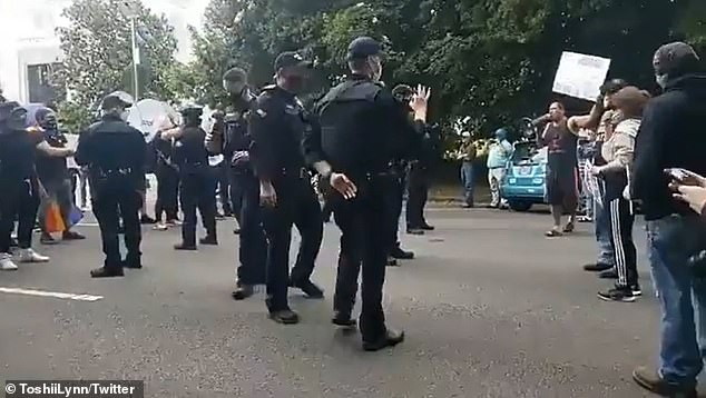 An officer withThe Department of Oregon State Police was accused of making a white power hand gesture during a Black Lives Matter demonstration in Salem, Oregon
