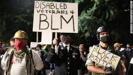 A group of veterans join the protest.
