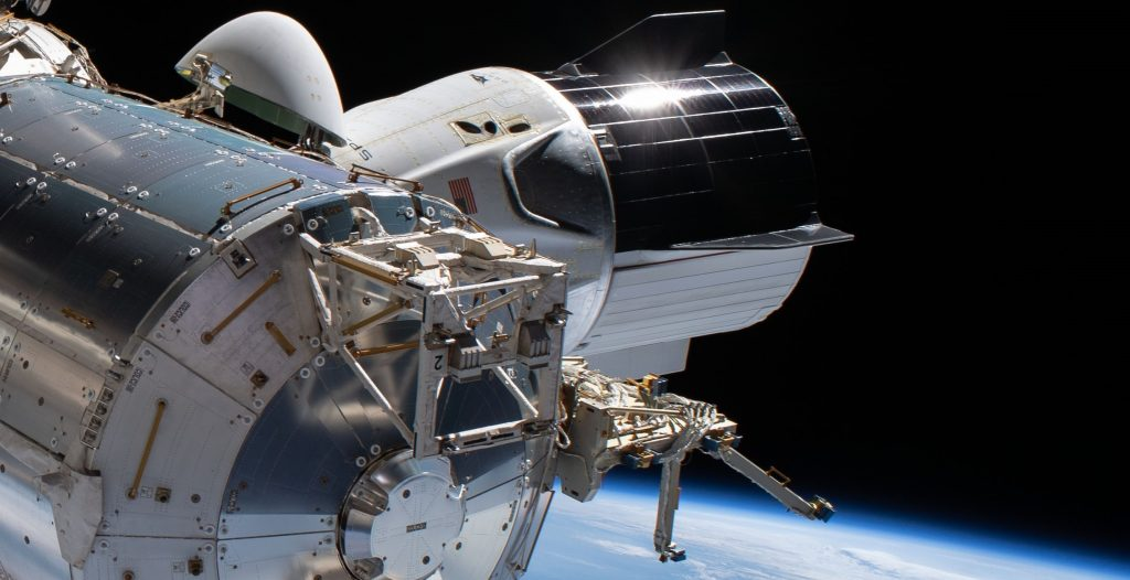 SpaceX Crew Dragon spacecraft caught on camera in the course of NASA astronaut spacewalk