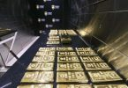 Gold surges to record high $US2,055, Australian shares to follow Nasdaq higher