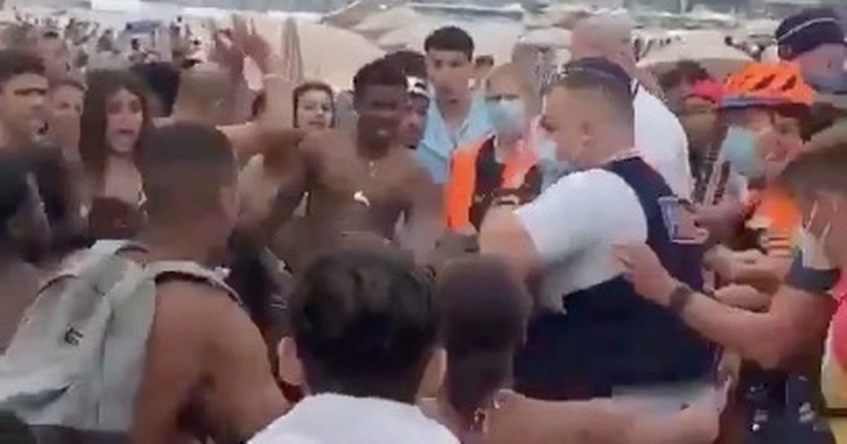Massive brawl breaks out on beach with umbrellas and sunbeds used as weapons - World News