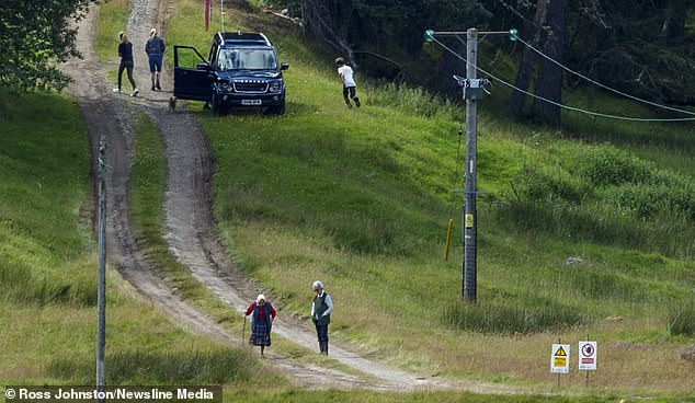 The Queen took to the hills and was in good company, as three people - who appeared to be Sophie Wessex and her two children,Lady Louise Windsor and James, Viscount Severn, stepped out of the car