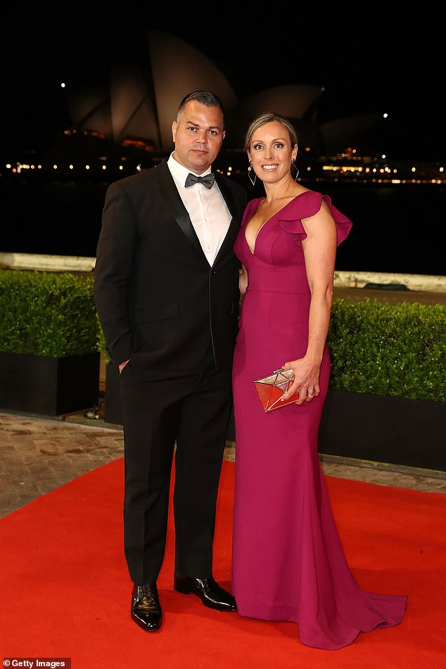 The Brisbane Broncos coach is pictured with his wife Hollyat the 2018 Dally M Awards in Sydney