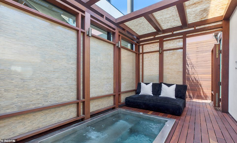 Spa day: For an extra layer of luxury, a small spa is built into a wooden deck, inside a peaceful private courtyard