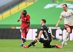 Arsenal's Emiliano Martinez saves from Liverpool's Sadio Mane.