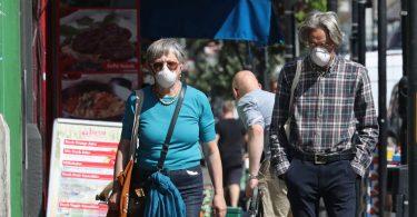 People wear face masks