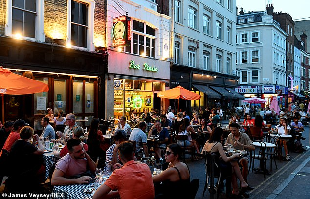 The number of people over 50 who tested positive for Covid-19 is now only a fifth of the number nationwide, compared to three quarters in the spring. Pictured is diners on Frit Street, Soho, on August 11th
