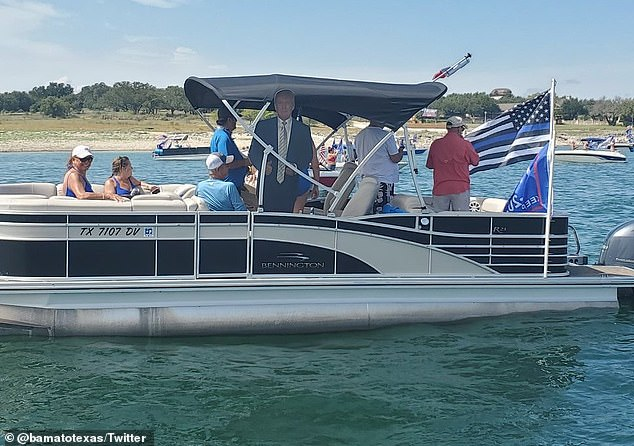 A life-size cut of the president was seen on a pontoon boat on Lake Travis during the parade