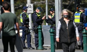 Police patrol a street in Melbourne on September 6, 2020 as the state announced an extension of a strict lockdown law as it combats the novel coronavirus outbreak.