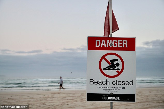 A sign in Greenmount Beach alerts swimmers and surfers that the beach is closed on Wednesdays