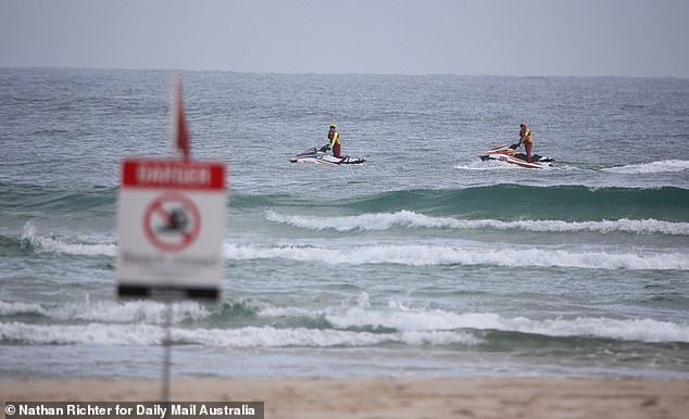 Pictured: Rescuers on jet skis search the waters at Greenmount Beach on Wednesday