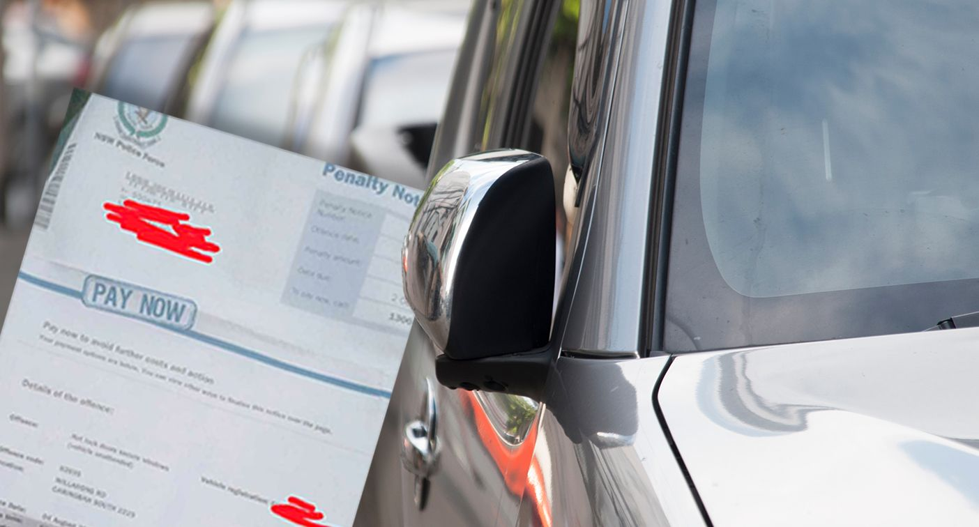 A photo showing the driver's penalty notice for failing to close their window.