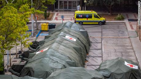 Military tents were set up for hospital patients at Gomes First Military Hospital in Madrid, Spain, on Friday.