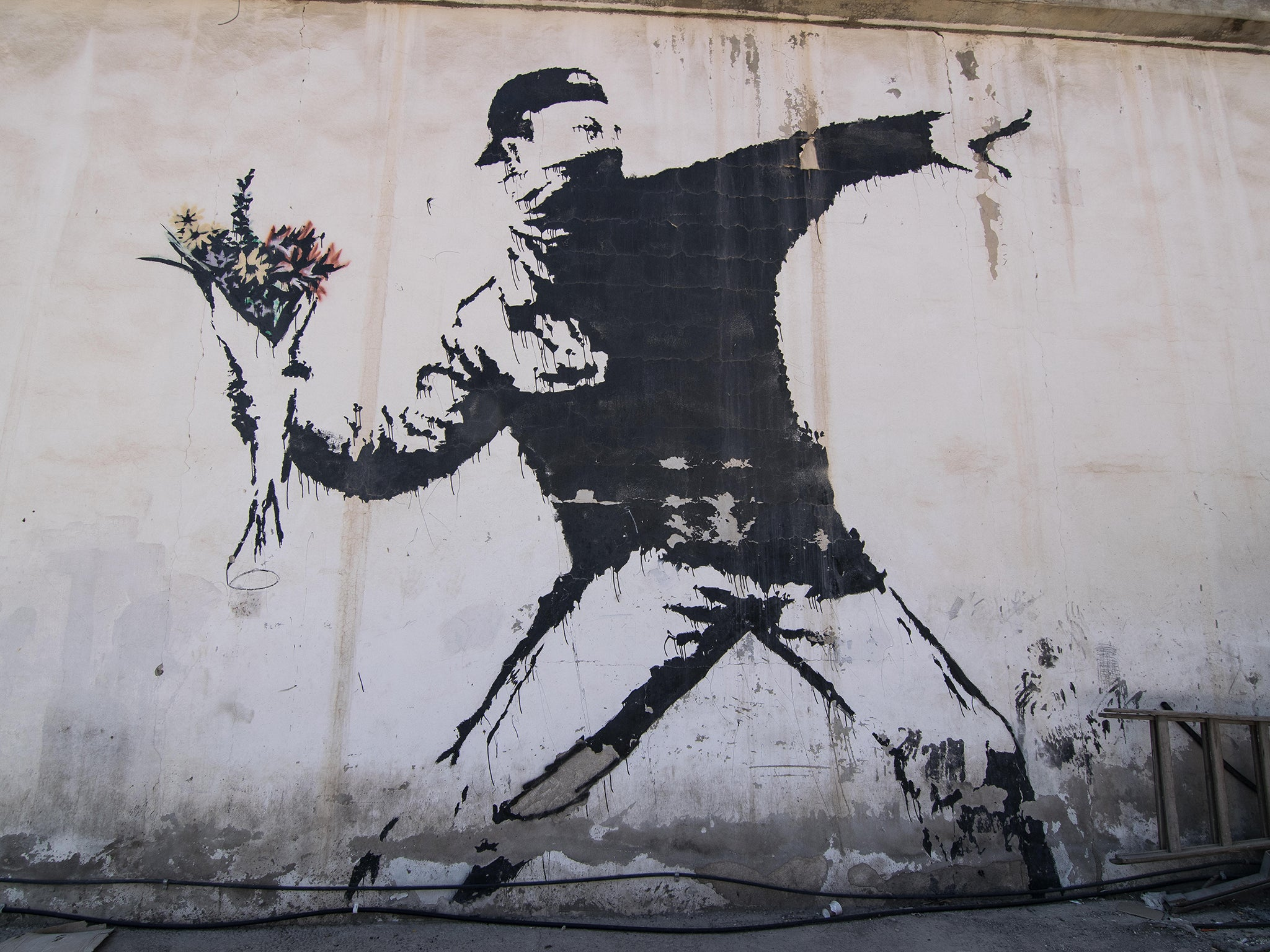"""Banksy loses art trademark battle with greeting card company in """"devastating"""" ruling."""
