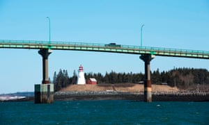 Cars cross the international bridge between Lübeck, Maine (left) and Campobello Island, Canada on March 3, 2017. Lübeck is the easternmost city in the United States bordering the border crossing with Canada.  Credit: AFP PHOTO / Don Emmer