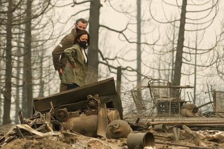 Gavin Newsom and Kamala Harris assess the damage caused by a creek fire in Obury, California.