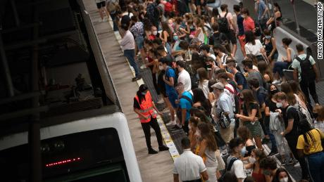 Students wait for a train to the university, during rush hour in Barcelona, Spain, on Thursday.