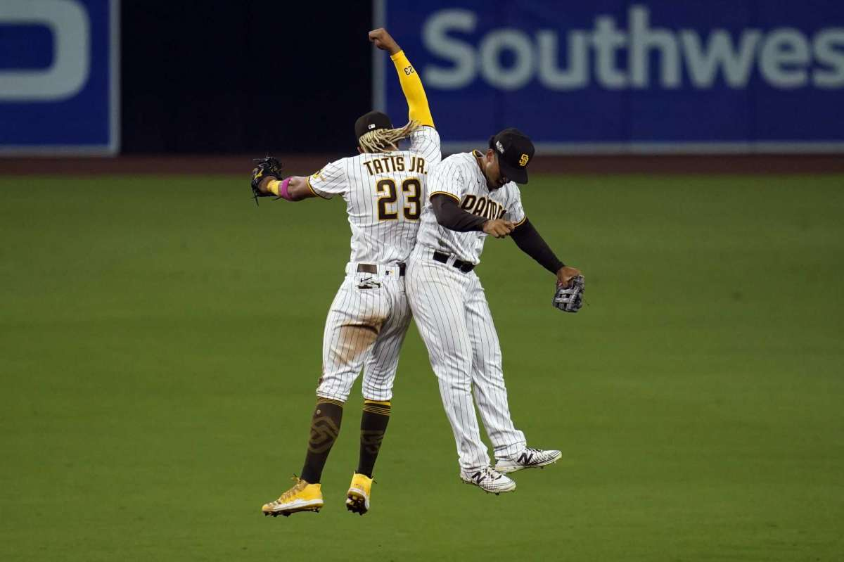 San Diego Padres Shortstop Fernando Tates Jr., left, celebrates right-hand player Trent Gresham after he defeated Padres St. Louis Cardinals 11-9 in Match 2 of the National League Baseball Series on Thursday, October 1, 2020, in San Diego.