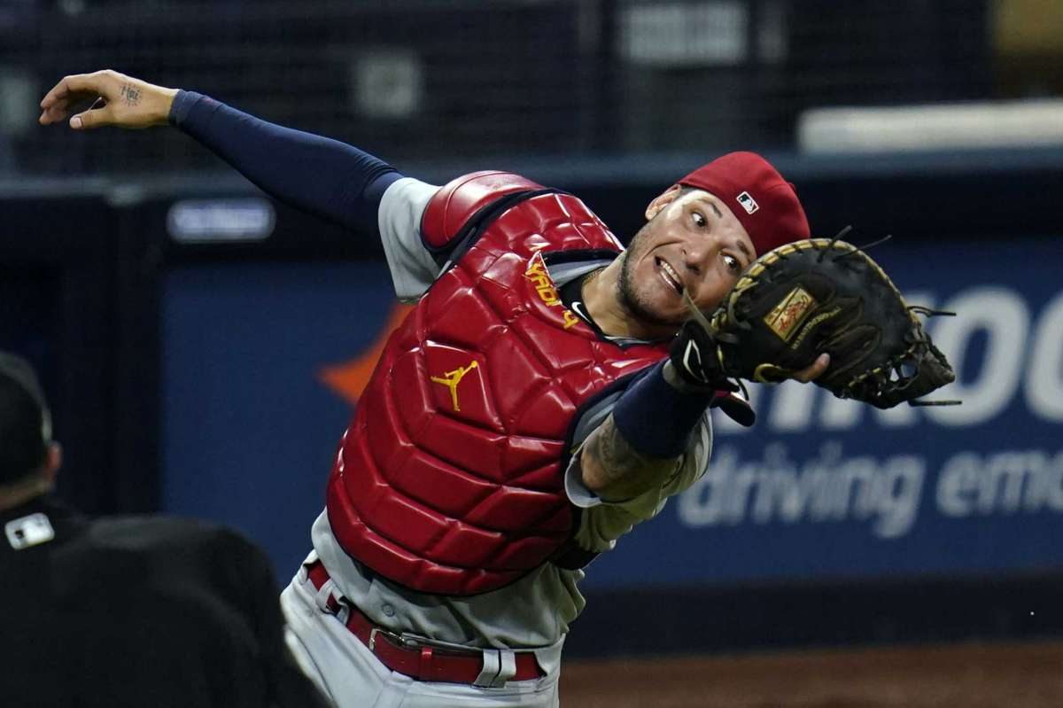 St.Louis Cardinals hunter Yadier Molina picks up a foul ball to break out on Eric Hosmer of the San Diego Padres team during the eighth round of the second game of the National League Baseball Series on Thursday, October 1, 2020, in San Diego.
