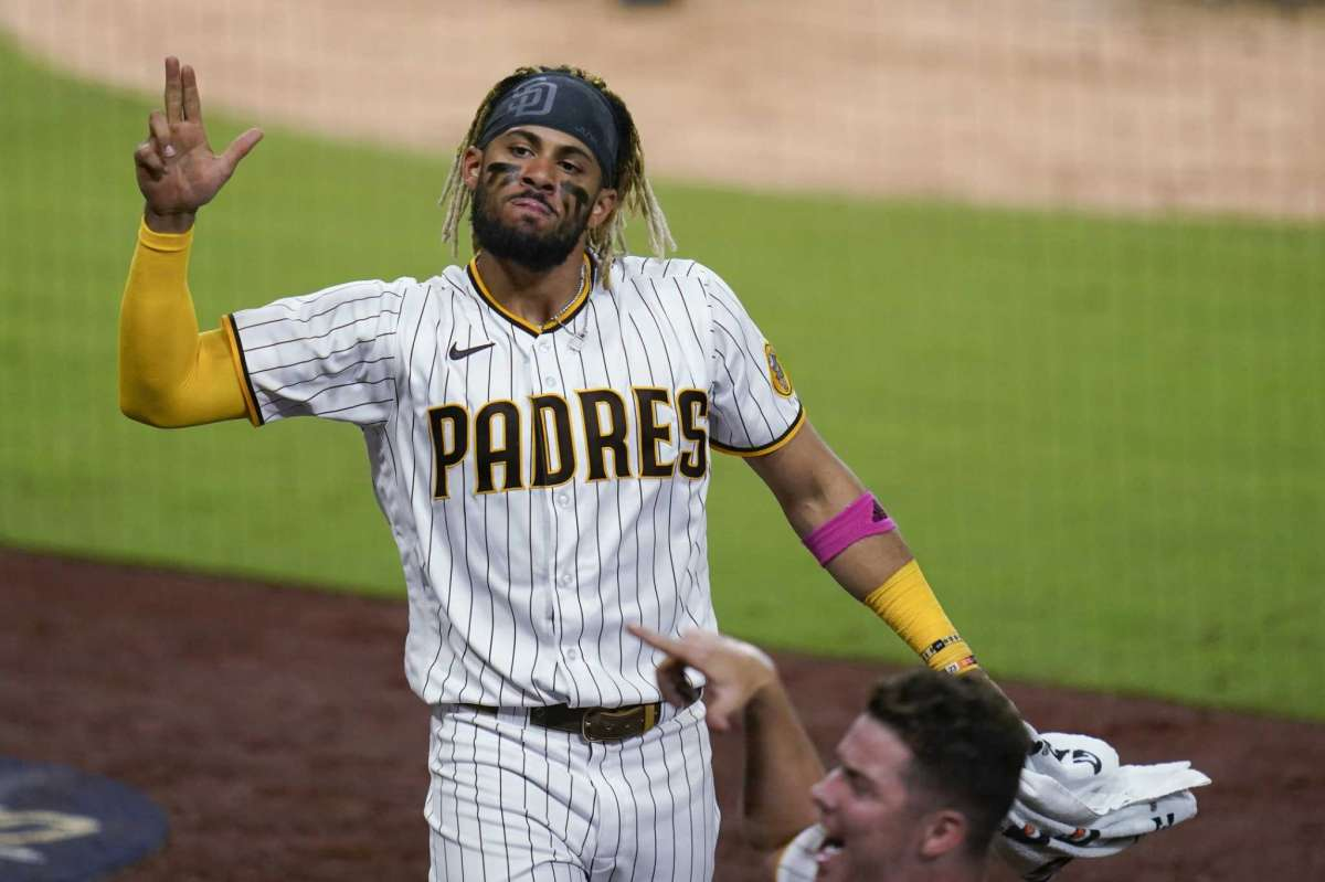 Fernando Tatis Jr. of San Diego Padres points out alongside his teammate after being run on home by Will Myers during the seventh game of the second game of the National League Baseball Series against the St. Louis Cardinals, Thursday October 1, 2020, in San Diego.