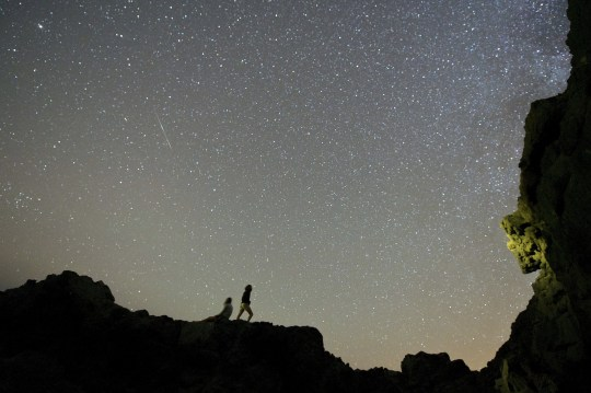 Mandatory credit: Photo by Carlos De Saa / EPA / REX (8109478a) Hikers admire the starry skies during the meteoric delta showers on El Valle Beach in Fuerteventura, Canary Islands, Spain early morning July 27, 2014 Spain Betancuria (Fuerteventura) Spain Delta Aquarids Meteor Shower - July 2014
