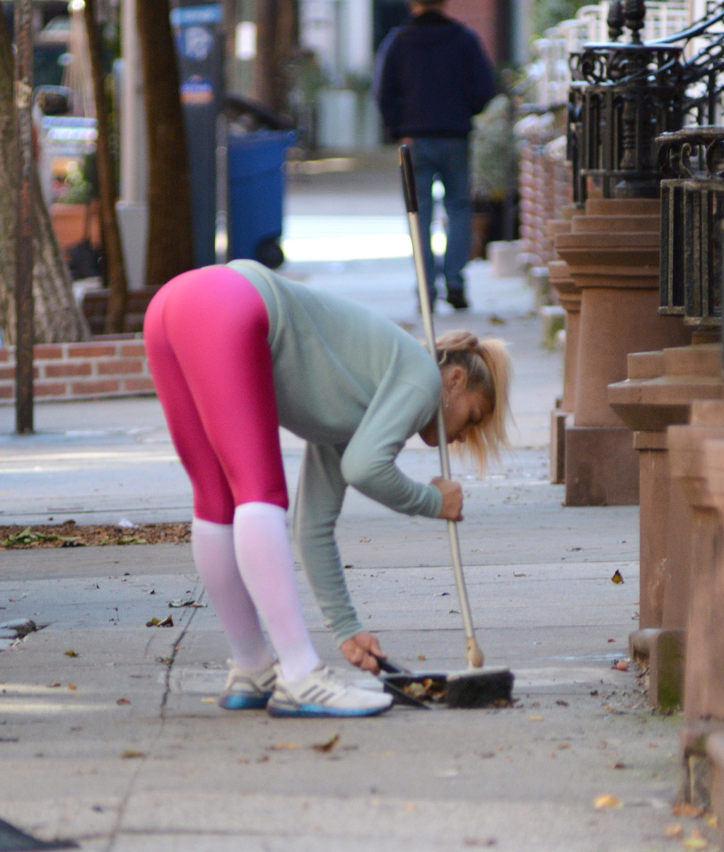 Exclusive: Busy Phillips sweeps some papers in NYC.