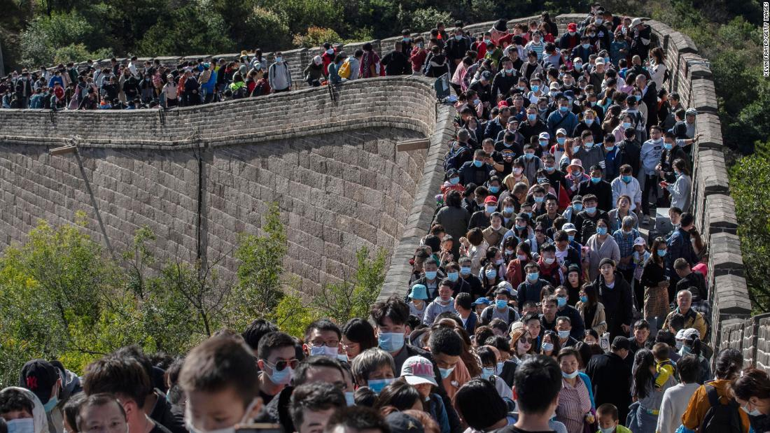 Which pandemic? Crowds sweep across the Great Wall of China during the holiday week