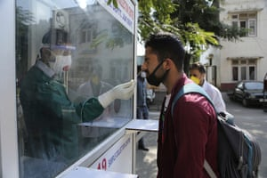 A health worker collects a nasal swab sample for Covid-19 test at a government hospital in Jammu, India.