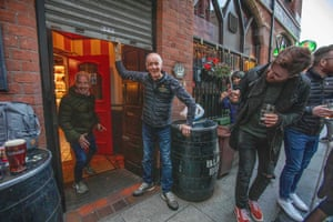 Bittles Pub owner John Bittles closed a bar in Belfast on October 16, 2020, as Northern Ireland imposes tougher coronavirus restrictions on the hospitality sector amid a spike in Covid-19 cases.