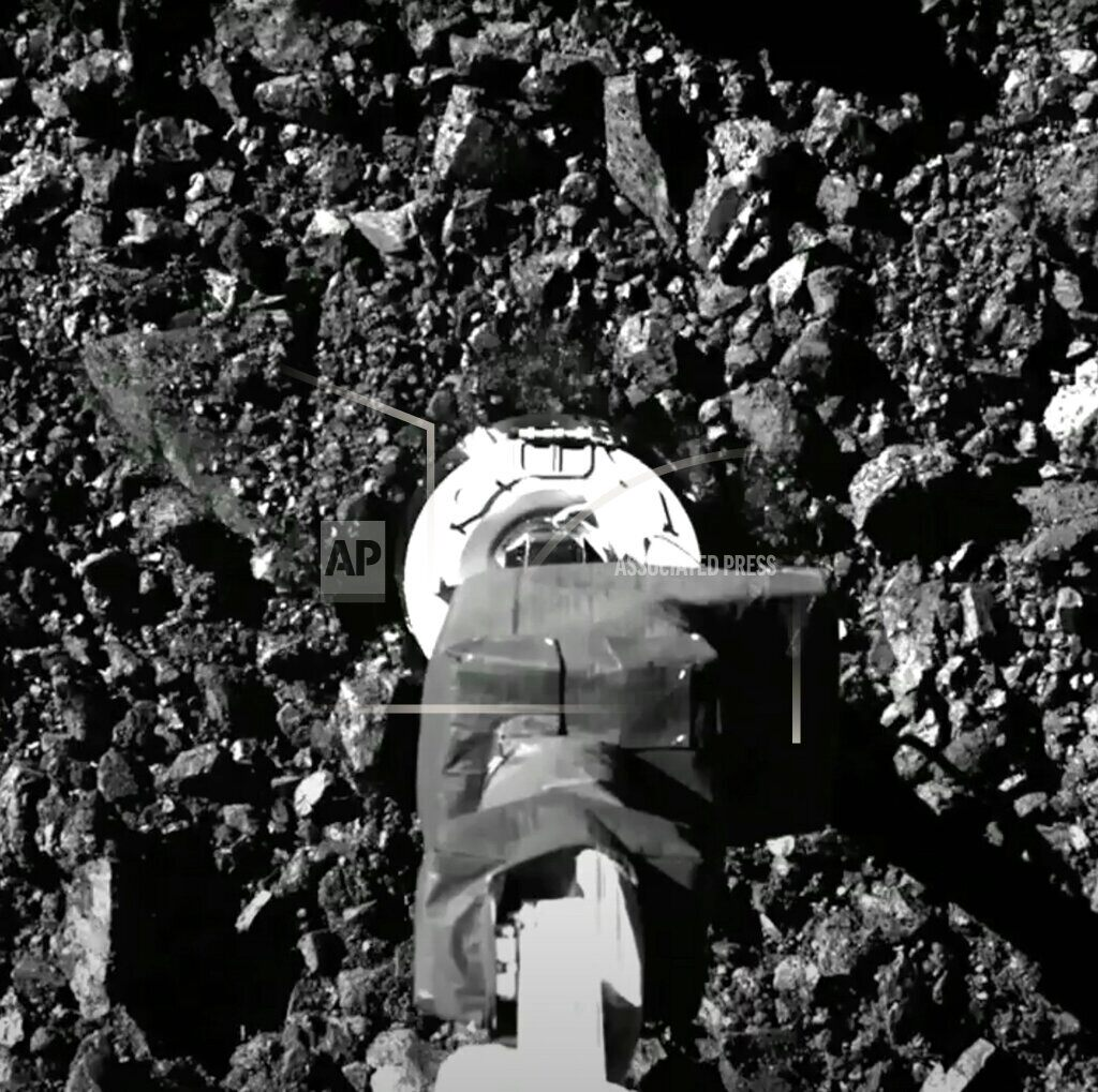 Asteroid samples escaping from a NASA spacecraft jammed
