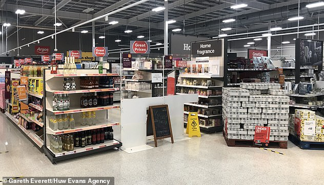Supermarkets in Wales cordoned off their store aisles after Wales imposed a ban on