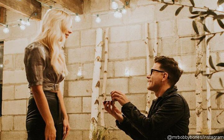 """Bobby Bones feels """"luckiest"""" after getting engaged to girlfriend Caitlin Parker"""